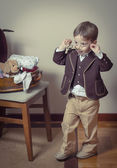 Vintage portrait of boy playing with old glasses — Stock Photo