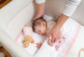 Hands of mother caressing her baby girl sleeping — Foto Stock