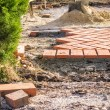 Stock Photo: Orange brick paving stones in construction process