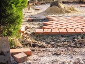 Orange brick paving stones in construction process — ストック写真