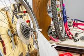 Wheels and bicycle parts over workshop table — Stock Photo