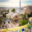 Ceramic bench and entrance pavilion of park Guell — Stock Photo