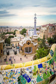 Ceramic bench and entrance pavilion of park Guell — Stock fotografie
