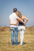 Love couple embracing outdoors on a summer day — Stock Photo