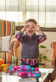 Funny kid making monster face and playing in home — Stock Photo