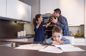 Sad child suffering and parents having discussion — Stock Photo