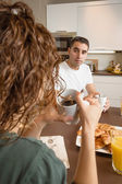 Serious couple with problems speak at breakfast — Stock Photo
