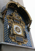 Golden clock on building wall in Paris — Stock Photo