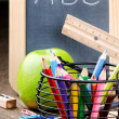Chalkboard and colorful crayons — Stock Photo