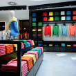 Stock Photo: Colorful clothes shop interior