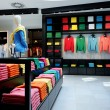 Colorful clothes shop interior - Stock Photo