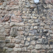 Old stone wall with lantern — Stock Photo #12672649