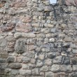 Old stone wall with lantern — Stock Photo