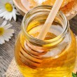 Glass honey pot and comb — Stock Photo