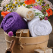 Wooden pail with bath accessories - Stock Photo