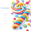 Colorful lollipops and smarties — Stock Photo #12677493