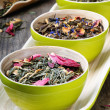 Mix of dry green and flower tea - Stockfoto