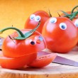 Funny tomatoes with googly eyes - Stock Photo