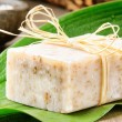 Stockfoto: Natural handmade soap on green leaf