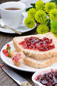 Breakfast with toasts, coffee and jam — Stock Photo