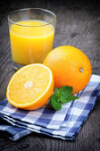 Glass of orange juice and fresh fruits — Stok fotoğraf