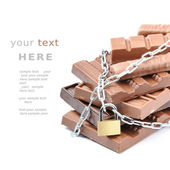 Chocolate bars tied up with chains — Stock Photo