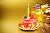 Colorful birthday cake with candle — Stockfoto