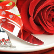 Stock Photo: Red rose and cutlery on white plate