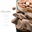 Crushed dark chocolate with cocoa beans — Stock Photo