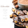 Chocolate with hazelnuts, cocoa powder and cinnamon - Stock Photo