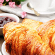 Breakfast with coffee, croissant and jam - Stock Photo