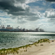 Dirty coastline of industrial port - Stock Photo