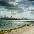 Dirty coastline of industrial port - Stockfoto