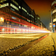 Urban city road with car light trails at night — Stock Photo