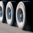 Truck wheels in motion — Stock Photo #12727800