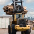Stock Photo: Skidder hauling logs
