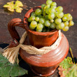 Ceramic jug with wine grape — Stock Photo