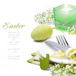 Easter table setting with candle and flowers — Stock Photo