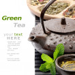 Asian teapot with green tea selection - Stok fotoğraf