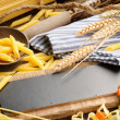 Rustic wooden board with pasta assortment — Stock Photo