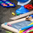 Colorful school supplies on wooden desk — Stock Photo