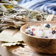 Sea salt mix with juniper berries and rosemary - Stock Photo
