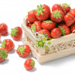 Small wooden crate with strawberries — Stock Photo