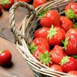 Strawberries in basket — Stok fotoğraf