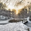Wooden bridge under snow - Stock Photo