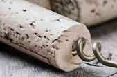 Wine corks on wooden table — Stock Photo
