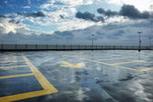 Rainy rooftop parking — Stock Photo
