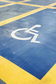 Parking space reserved for handicapped person — Stock Photo