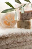 Olive soap and bath towels — Stock Photo