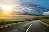 Coastal road at sunset — Stock Photo